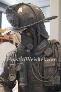 """Forced Entry"" Bronze firefighter sculpture"