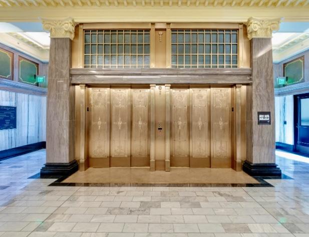 Bronze elevator doors / wall, hand sculpted by Austin Weishel.