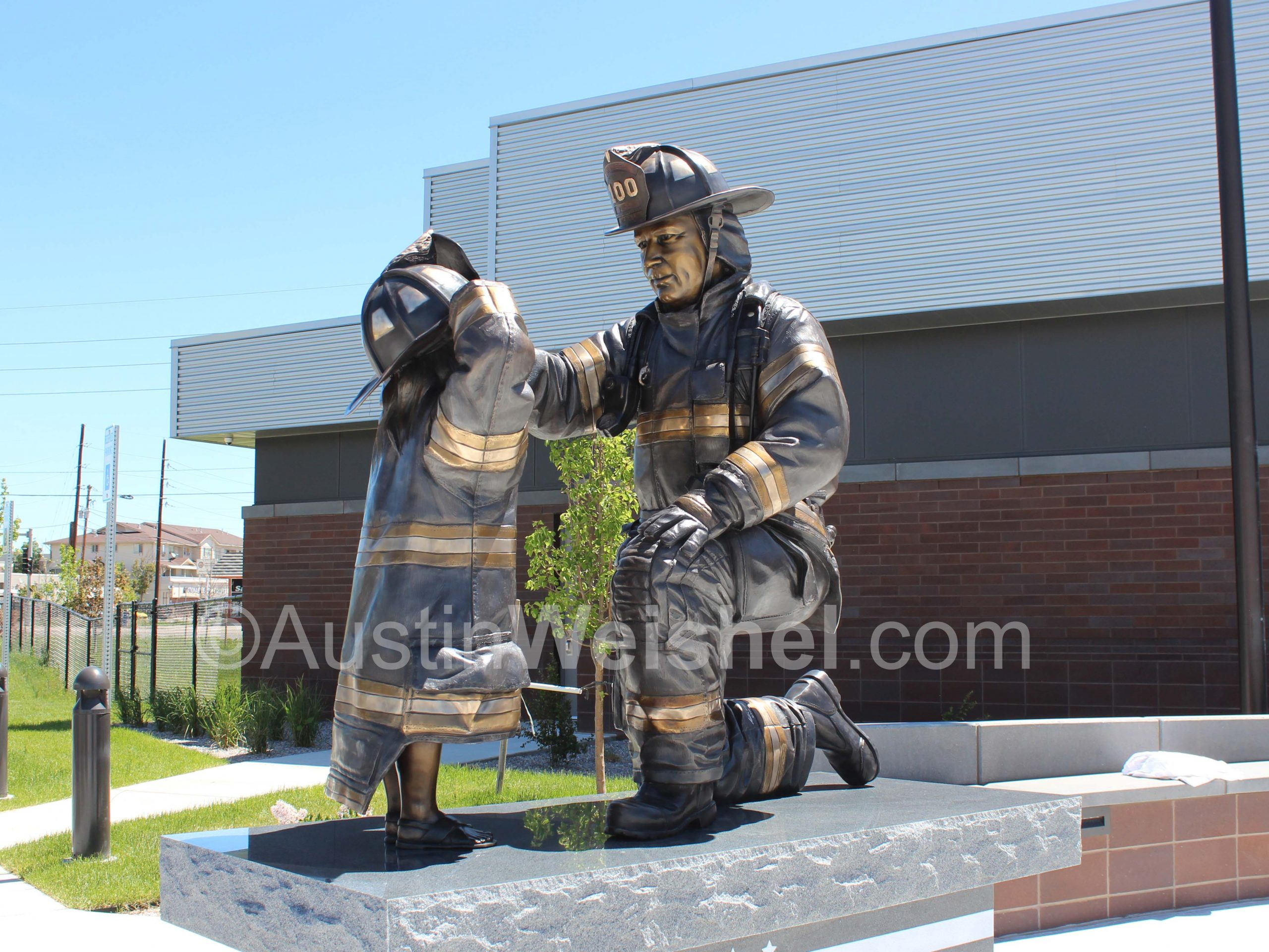 Austin Weishel hand sculpted a bronze firefighter tribute sculpture to honor the past, present, and future firefighters of Adams County Fire Rescue in Denver, Colorado